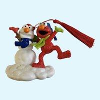 Sesame Street Elmo Building a Snowman Ornament