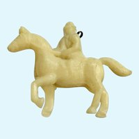 Vintage Celluloid Man Riding Horse Charm Early Plastics