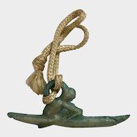 Vintage Early Plastics Man in Canoe Jewelry Charm