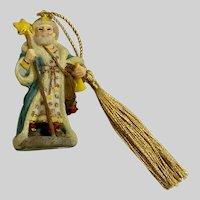 Santa Claus Holding a Star Christmas Ornament
