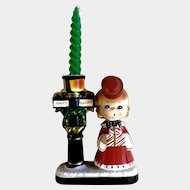 Blume The Christmas Corner, Happy Holiday Candle Stick Holder Caroler Girl with Presents Next to a Street Light Japan Ceramic Figurine
