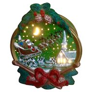 Vintage Christmas Night Light Santa Claus Sleigh and Reindeer Flying over a Town Church Ceramic Figurine