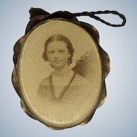 Antique Locket with Sepia Toned Photograph of a Woman