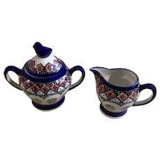 Cream and Sugar Bowl Unikat Polish Art Pottery Blue Bird with Pinwheel Pattern Signed by Artist Agata Rusiecka and Aniva Ziembikiewicz