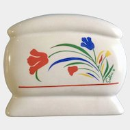 Saltera Napkin Holder with Red, Blue and Yellow Flowers, White Kitchen Table