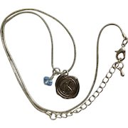 Lovely Initial K Silver-tone Necklace with a Dangling Blue Sparkle Bead