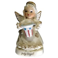 Napco July Birthday Angel Girl Holding Uncle Sam's Patriotic Hat Spaghetti Trim Ceramic Figurine Made in Japan A1367