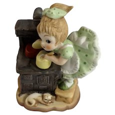Bisque Girl Doing Chores Cooking with Cat Pantaloons Made in Japan Figurine