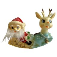 Mid-Century Plastic Rubber Baby Blue Reindeer with Santa Claus in Sleigh Vintage Rocking Gold Glitter Christmas Figurine 7""