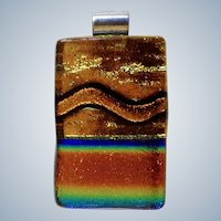 Elegant Art Glass Pendant with Rainbow of Colors and Luminous Orange Design