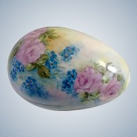 Genevieve (Gen) Moedy (1924-2017) Hand Painted Porcelain Egg with Pink Roses and Blue Flowers trinket Box Signed