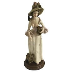 A. Santini Lady with Two Yorkshire Terrier Dogs Hand Painted Resin Woman Figurine with Wood Base