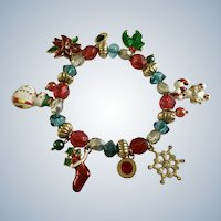 Christmas Charm Bracelet with Snowman, Stocking, Snowflake, Candy Canes, Holly and Poinsettia Flower