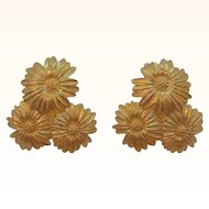 Vintage Monet Goldtone Metal Trio Of Daisy Flowers Clip on Earrings