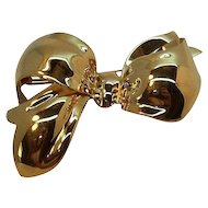 Vintage Monet Shiny Dimensional Goldtone Metal Bow Brooch