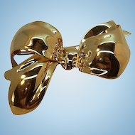 Vintage Monet Shiny Dimensional Goldtone Metal Bow Brooch