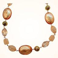 Vintage Goldtone Metal Orange Faceted Lucite Foil Filled Beaded Necklace