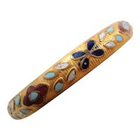 Enameled Flower Accents Textured Goldtone Metal Bangle Bracelet