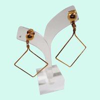 Large Thin Diamond Shaped Goldtone Metal Dangle Clip On Earrings