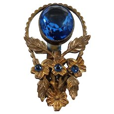 Art Deco Textured Goldtone Metal Unfoiled Blue Glass Stone Dress Clip