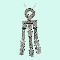 Geometric Design Silvertone Metal Dangle Articulated Cubic Zirconium Pendant Necklace