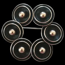 Circle of Discs Sterling pin brooch by Modernist N.E. From of Denmark Mid Century