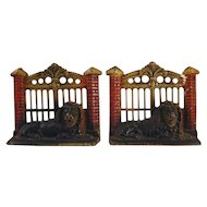 Vintage Painted Cast Iron Bookends Lion in Front of Metal Gate