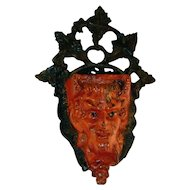 Antique Cast Iron Match Holder  Devil's Head Cup with Foliage Background  Original Orange and Black Paint