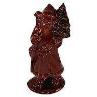 1988 Foltz Glazed and Sponge Decorated Redware Santa Clause Carrying Christmas Tree And Gift Basket on His Back