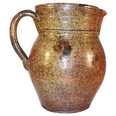 Antique Manganese Glazed  Redware Pitcher With Applied Handle  Southeastern Pennsylvania