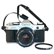 Nice 35 Millimeter SLR Camera Canon AE-1 With FD 50mm 1:1.8 Lens & 50mm Filter