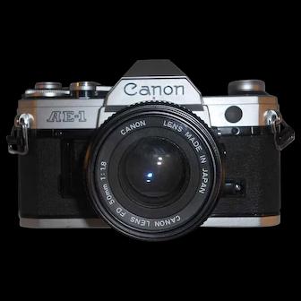 Good 35 Millimeter SLR Camera Canon AE-1 With FD 50mm 1:1.8 Lens+52mm UV Filter