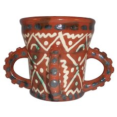 Mid 20th Century Glazed Slip Decorated 4 handled Redware Mug by James Seagraves