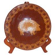 1984 Foltz Glazed Brown Redware Plate Yellow Mottling and Slip Pig or Hog Image