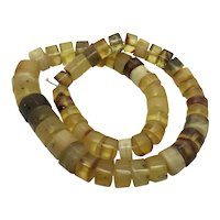 Strand of Yellow Amber Cut Disk Graduated Necklace