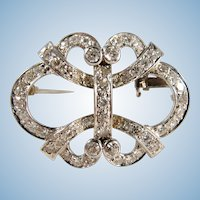French platinum and 2.105ct t.w. diamond brooch with intricate open work design Ca. 1920s Hallmarked