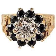 Fabulous flower cluster ring in stamped solid gold with 10 sapphires and one round cut diamond