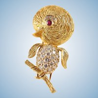 Estate 18K solid gold brooch Delightful vintage bird covered with brilliant cut diamonds and ruby eyes