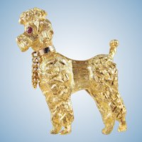 18K solid gold three-dimensional Royal poodle with ruby eyes Heavily textured and perfect condition