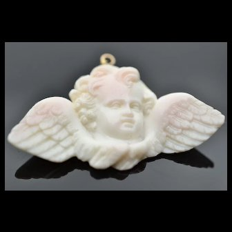 Our sweet victorian carved baby angel cherub in angel skin coral and 14k yellow gold