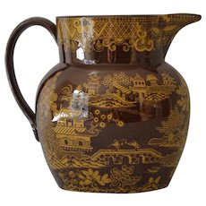Antique Pottery Chinoiserie Jug with Yellow Transfer