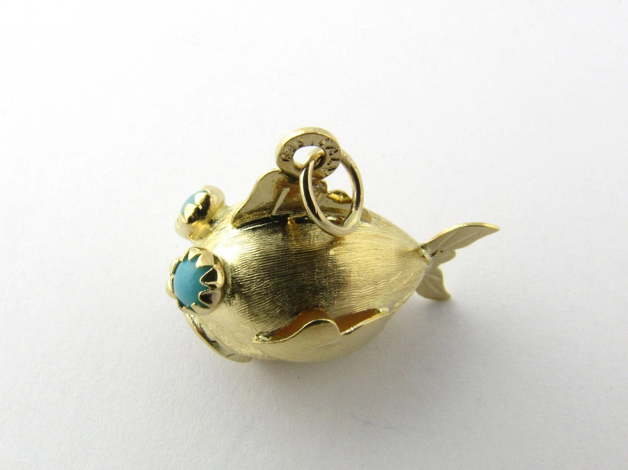 Vintage 18k yellow gold fish charm with turquoise eyes for Gold fish charm