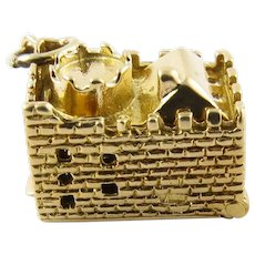 Vintage 9 Karat Yellow Gold Articulated Castle and Cannon Charm