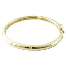 Vintage 14 Karat Yellow Gold and Diamond Bangle Bracelet