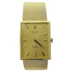 Rolex 18K Yellow Gold Men's Watch  Model: 4089  Serial: 4249383  This authentic Rolex Cellini Watch is from the 1970's  18K Yellow Gold case and band  Gold Dial and markers  Case is approx. 23mm x 28mm  Rolex Cal. 1600 manual wind mechanical movement