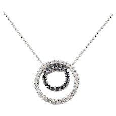 Vintage 14 Karat White Gold Black and White Diamond Circle Necklace