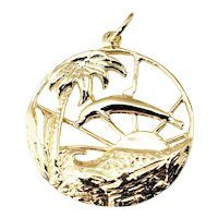 Vintage 14 Karat Yellow Gold Dolphin Sunset Palm Tree Pendant