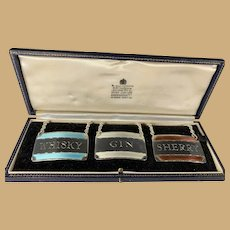 Set of Three Sterling and Enamel Bottle Labels - Collins & Cook