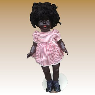 Black hard plastic doll marked A.S in a Heart