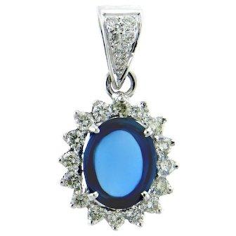 Captivating Blue Topaz and Diamond Pendant in 18 Karat White Gold